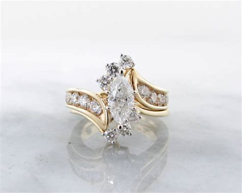 yellow gold wedding ring set fitted marquise