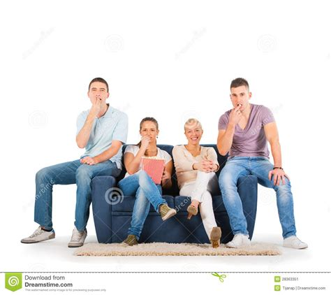 couch people young people sitting on a sofa smiling stock image image
