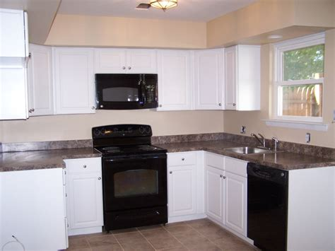 black appliance kitchen kitchen white cabinets black appliances kitchen white