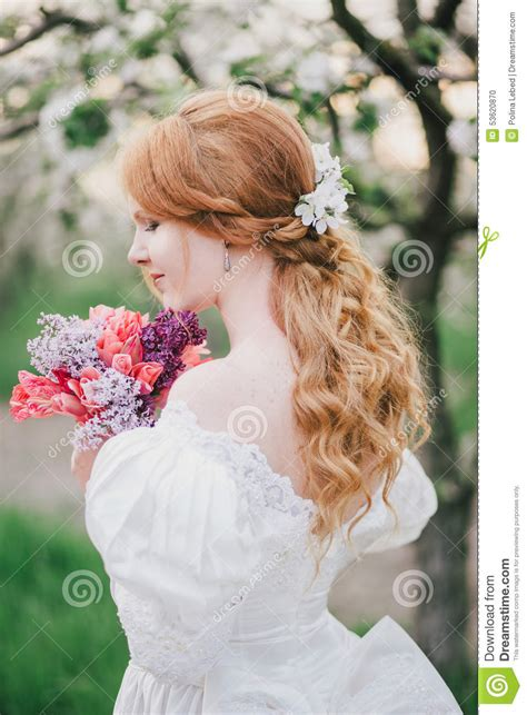 beautiful bride in a vintage wedding dress posing in a