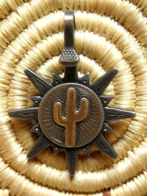 handmade jd moss spur rowel pendant