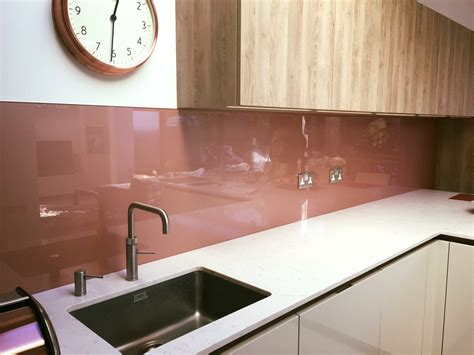 lovely contemporary copper coloured painted glass kitchen