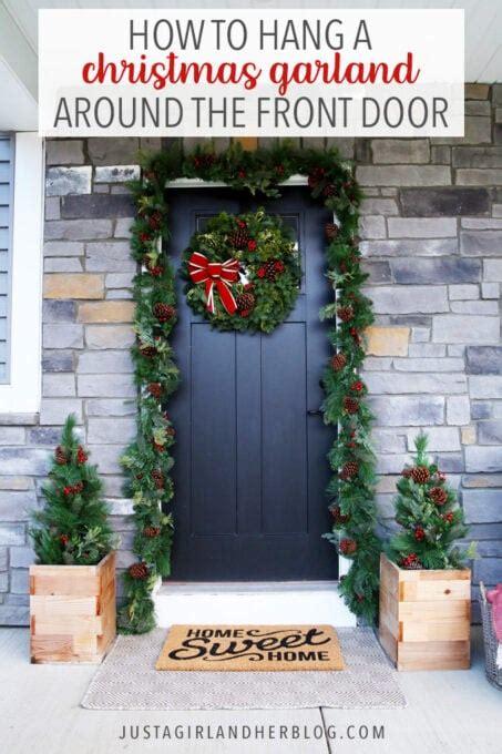 hang outdoor christmas garland   front door