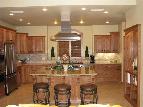 looking for paint colors to go with my honey oak cabinets previous pinner said so far the