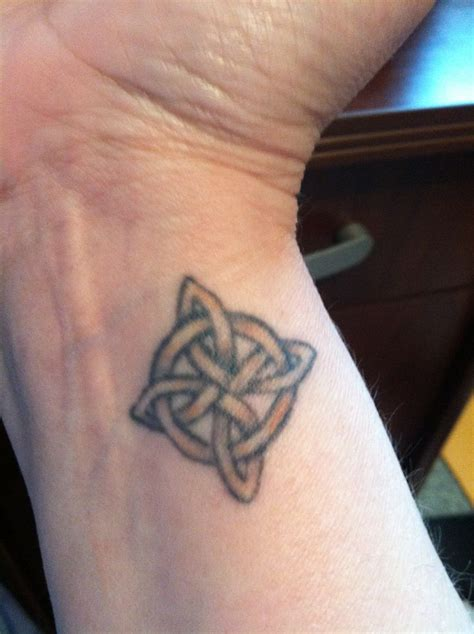 wrist tattoo 4 pointed celtic knot eternal love