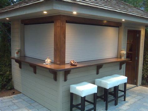 shutters on outdoors bar contemporary roller shades