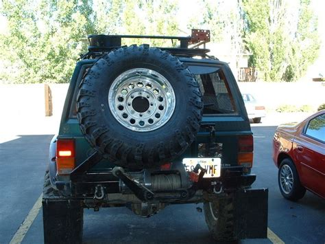 survival jeep cherokee tire carrier jeep cherokee xj mods pinterest tired