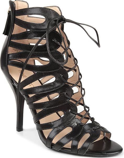 nine west kenie leather cage sandals in black lyst