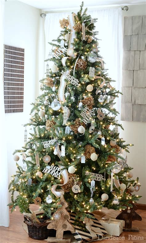 happy holidays home tour neutral christmas tree with gift