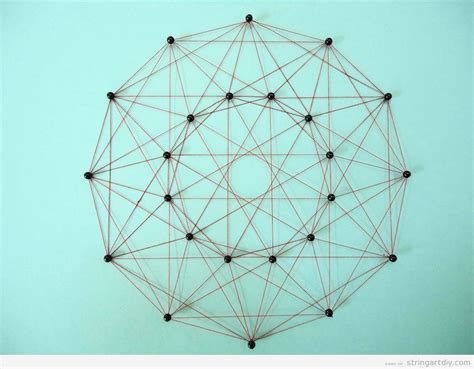 Math String Patterns Free - geometrical string made with thumbtacks and threads