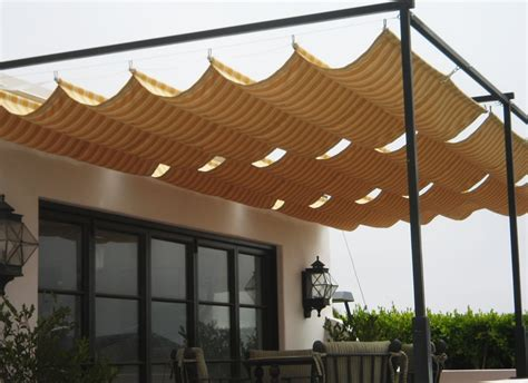 Retractable Canvas Awnings by Retractable Awnings And Drop Curtains And Shades Awnings