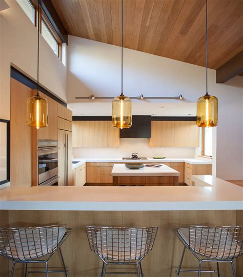 Modern Kitchen Island Lighting kitchen island pendant lighting emits golden glow in sun