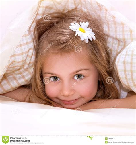 girl lying bed with flowers little girl in the bed stock photo image 38807030