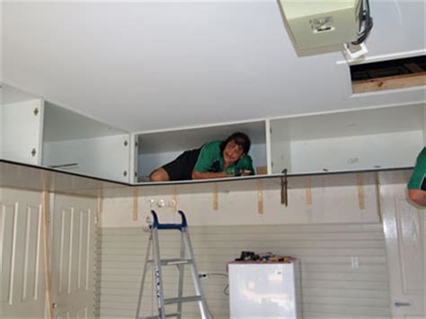 Garage Shelving Floor To Ceiling Garage Ceiling Cabinets Get It The Floor And Onto The