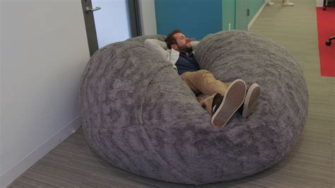 The internet is losing its mind over this gigantic fluffy pillow that's as big as a bed