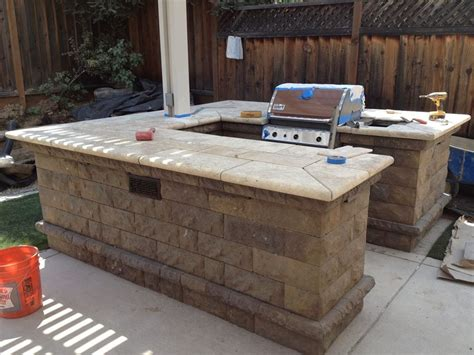 3 types of outdoor kitchens bbq belair w travertine top we design and create various types of outdoor elements
