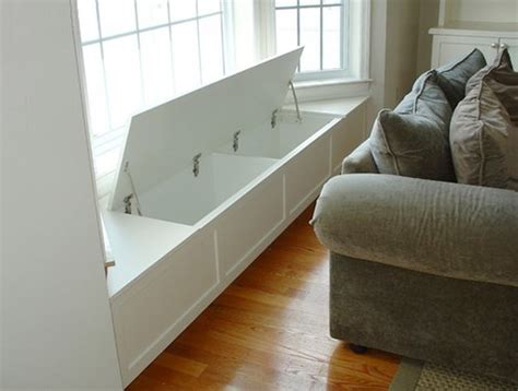 custom window seat cost a flip up lid reveals plenty of storage in this custom