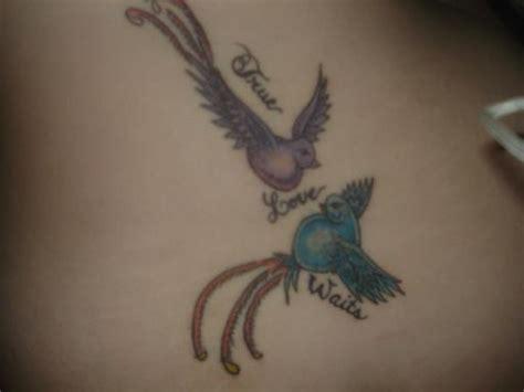 tattoo angel holding baby angel holding babies tattoos foot tattoos design