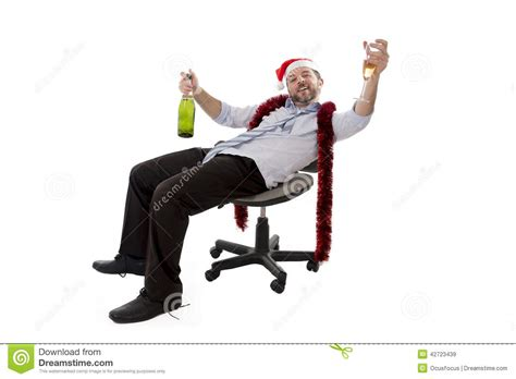 drunk business man drinking chagne at office christmas
