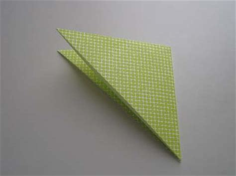How To Fold Paper Into A Triangle - origami squash fold how to make an origami