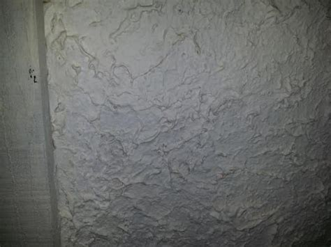 removing stucco   thick texture  walls