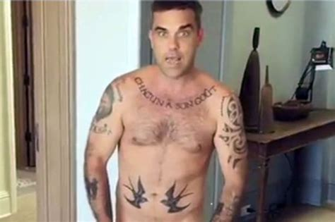 tattoo on robbie keane s wrist singer robbie williams in doghouse over four year old