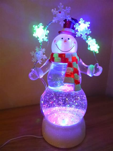 glittering christmas battery operated snow globes light up snowflake snowman snow globe with glitter battery operated uk gardens co uk