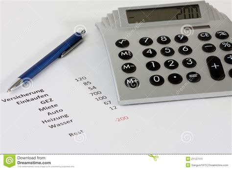 calculator negative calculator and a pen along with a negative budget stock