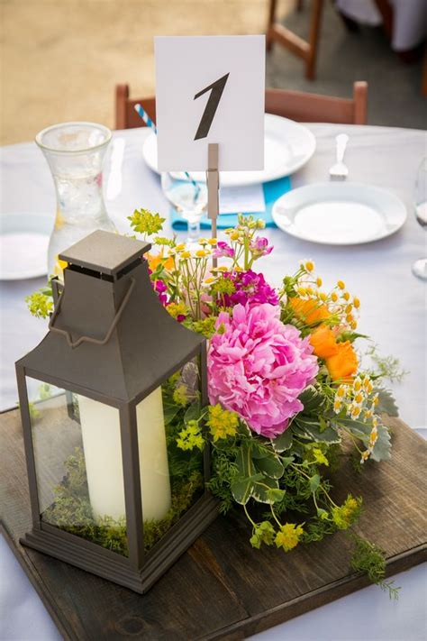 lantern style table ls lantern and floral centerpiece holds a graphic table