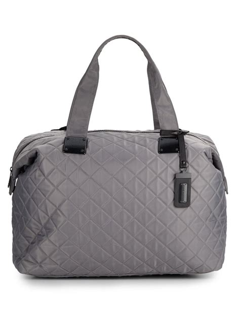 steve madden quilted duffle bag in gray lyst