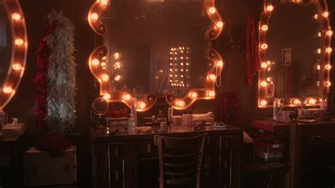 club dressing room medium angle of lighted mirrors in dressing room of club nightclub or lounge feather boas