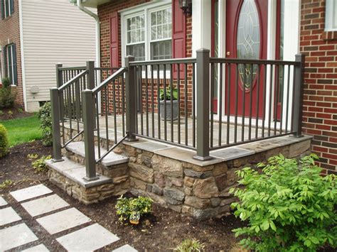 dark green front porch railing in a beautiful red brick