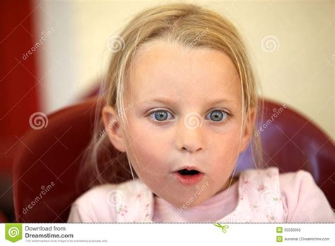 tiny small a surprised little girl royalty free stock photo image