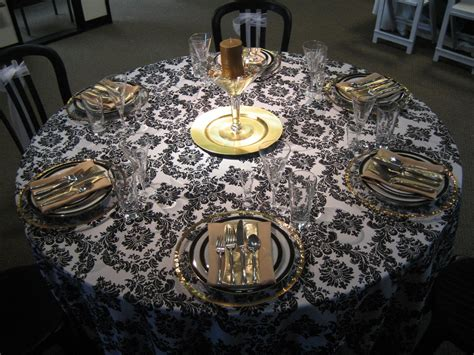 black and gold centerpieces black white and gold linen