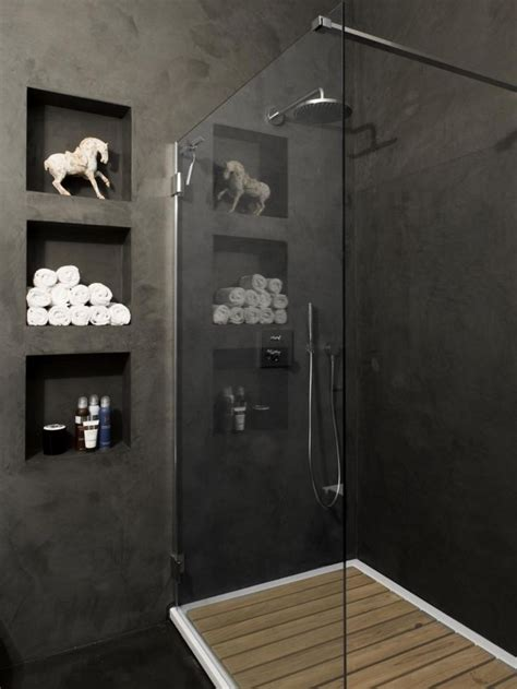 bathroom with grey walls cubby holes between studs