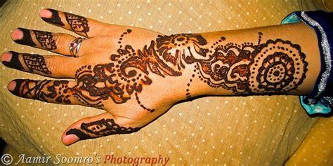 star henna tattoo butterfly tattoos finger arm flowers