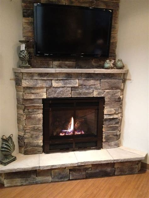 corner stone fireplace decosee tv above fireplace