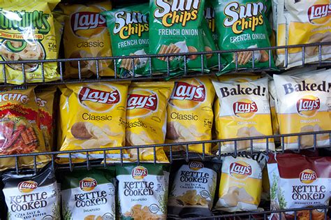 Shelf Of Potato Chips by Enticing Words On Bags Of Potato Chips A Lot To Say