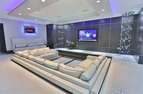 modern home theater with surround sound cove lighting in