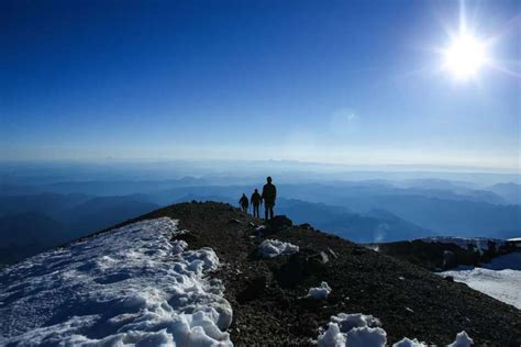 ascending the mountain 30 day devotional challenge books a climber negotiates a ladder placed a crevasse on