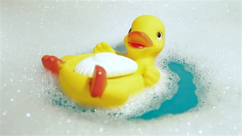 rubber duck in bathtub cute little baby having a bath and playing with yellow