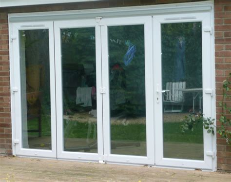 Folding Patio Doors Uk Concertina Doors Textured Window Panels Are Ideal For Allowing Light Flow Whilst Providing