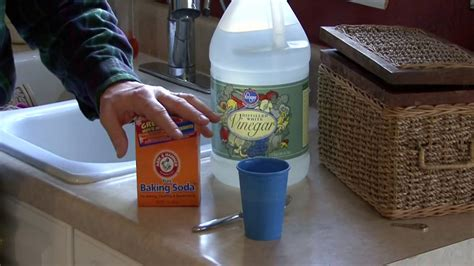 how to clean sink with baking soda unclog a kitchen sink with vinegar and baking soda