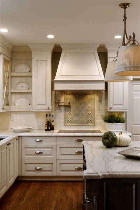 cream kitchen island accent back splash and creamy white cabinets kitchens