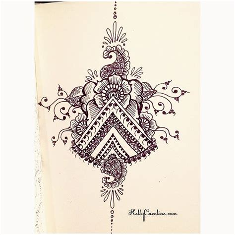 a new drawing in my notebook today with triangle henna