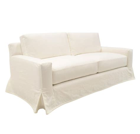white slipcovered sofa with skirt new yorker