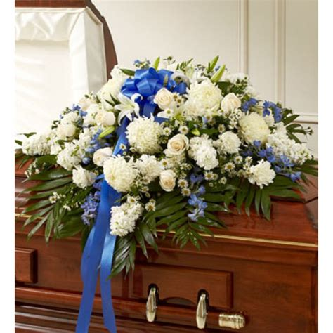 accents of blue funeral casket spray send to philippines