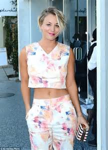 kaley cuoco almost unrecognizable with slicked down hairdo