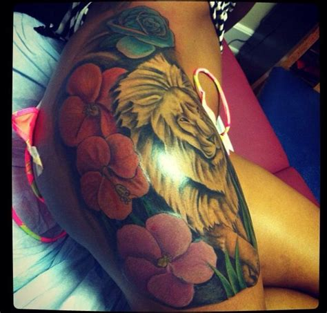 side but tattoo flowers lion tattoo ideas pinterest