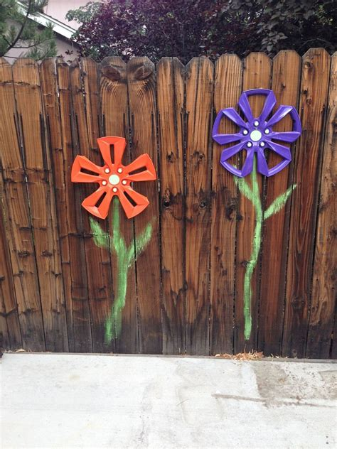 hometalk wheel cover fence flowers